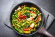 Stir fry vegetables in the wok.