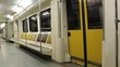 Moscow Metro. A new train car. An empty train car, early in the morning. The train is going in the tunnel. Behind the glass, wires and lighting lamps sweep. The car is shaking.