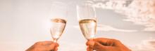 Couple Toasting Wine Glasses F...