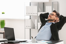 Handsome Businessman Relaxing In Office