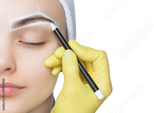 Fotografie, Obraz  Permanent make-up for eyebrows of beautiful woman with thick brows in beauty salon