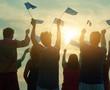 canvas print picture - Raising european union flags. Happy people against blue sky background.