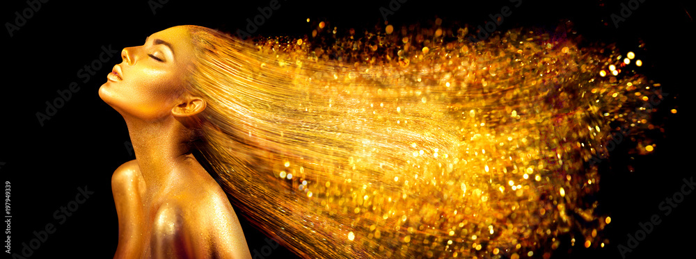 Fototapeta Fashion model woman in golden bright sparkles. Girl with golden skin and hair portrait closeup. Holiday glamour shiny professional makeup on black