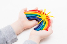 The Child Sculpts A Rainbow From Plasticine