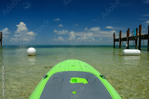 Lime green paddle board ready to head out into open waters off the Florida Keys