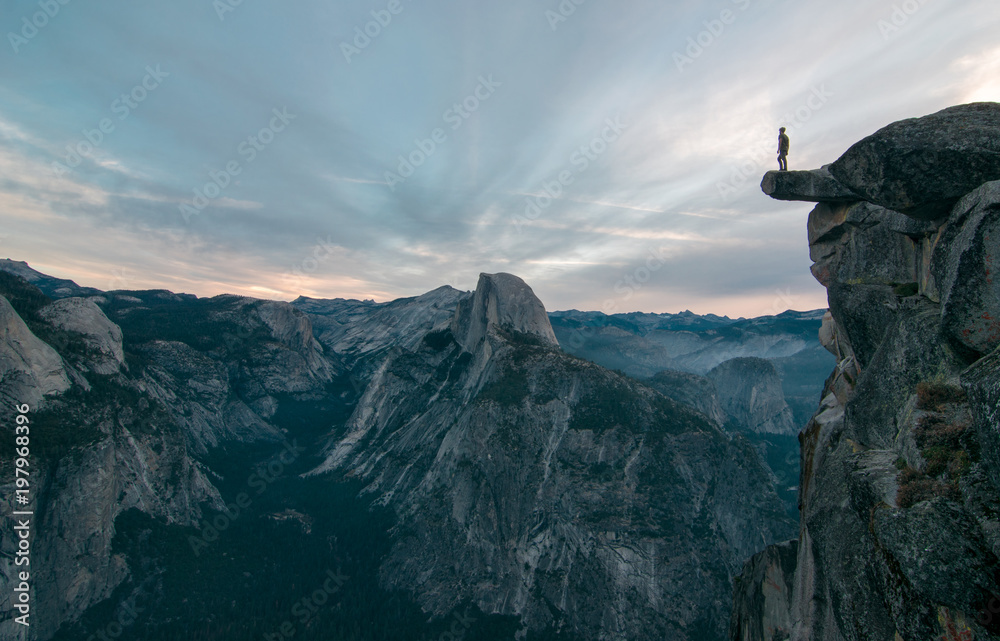 Fototapety, obrazy: Perhaps the best view of glacier point where this unknown adventurer dares to stand on the edge of a precipice