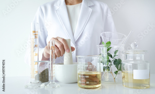 the scientist,doctor, make alternative herb medicine with herbal the organic natural in the laboratory Wallpaper Mural