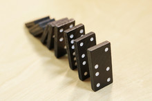 Falling Dominoes. The Domino Principle. The Domino Game...