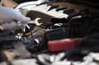 Mechanic repairing a car in garage Auto repair car engine, close u