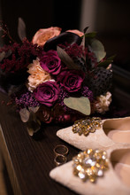 Wedding. Bridal Bouquet In Marsala Colors And Near A Beige Shoes With Shiny Stones On Them. Wedding Shoes With Sparkling Stones.
