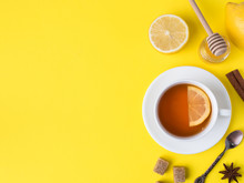 Flat Lay On The Yellow Bright Background Black Tea Lemon Cinnamon Star Anise Brown Sugar Jar Of Honey Copy Space
