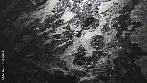 Valokuva  Arrière-plan noir avec tâches blanches