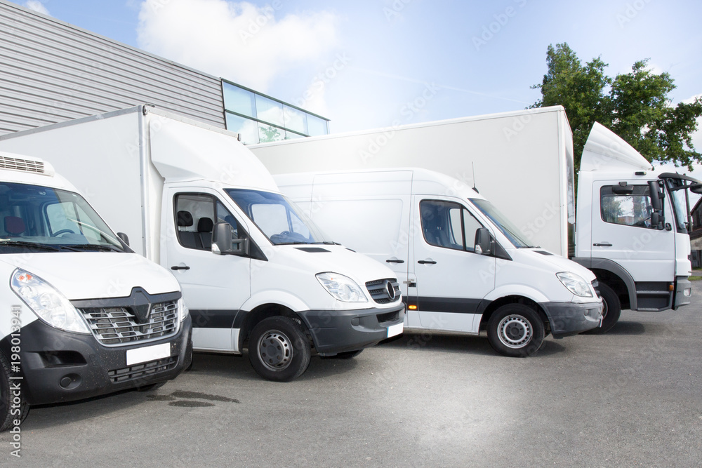 Fototapeta commercial delivery vans park in transport parking place of transporting carrier shipping service company