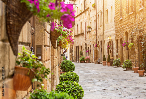 Fototapeten Schmale Gasse Colorful old street in Pienza, Tuscany, Italy