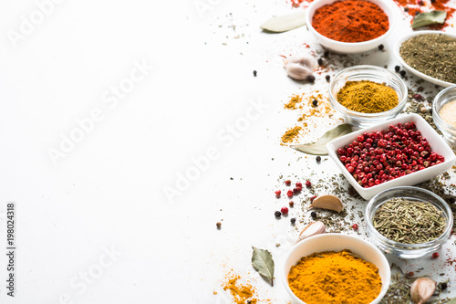 Canvas Prints Spices Spices in a bowls on white.