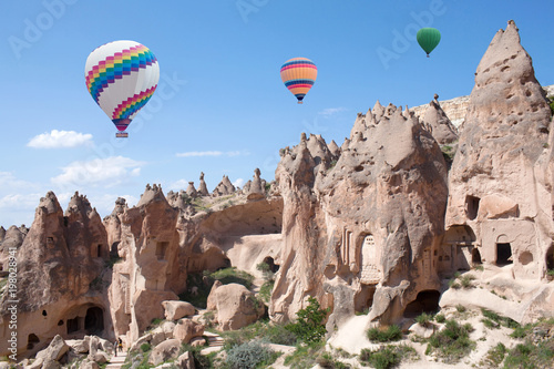 Colorful hot air balloons flying over Zelve valley, Cappadocia, Central Anatolia, Turkey