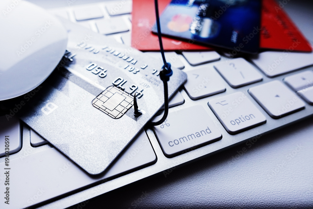 Fototapeta Credit card phishing attack concept, stealing credit card details with fishing hook on laptop keyboard