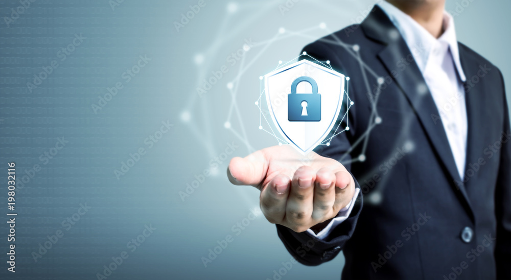 Fototapeta Protection network security computer and safe your data concept, Businessman holding shield protect icon