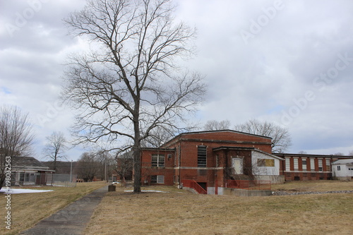 Photo Stands Route 66 Old abandoned and boarded up brick asylum hospital building