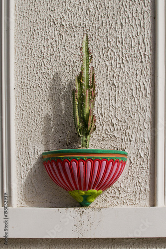 Cactus In A Hanging Pot On The Wall Of House Colored Pots Mexican