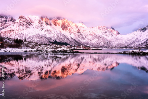 Papiers peints Rose clair / pale Scenery winter landscape in the Norway. Mountain ridge with reflection in the lake in gentle sunset light, Laupstad, Lofoten Islands