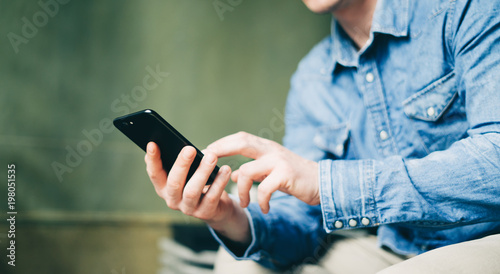Fotografie, Obraz  Young man with smartphone