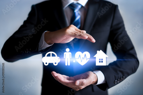 Businessman with protective gesture and car, family, life and health insurance icons. Insurance concept.