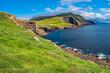 Panoramic view of Mykines at Faroe islands and North Atlantic puffins
