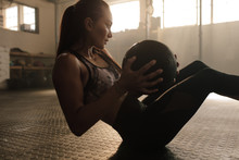 Determined Woman Exercising Wi...