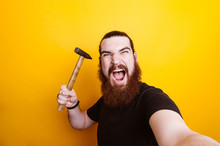 Angry Bearded Man With Hammer Making Selfie