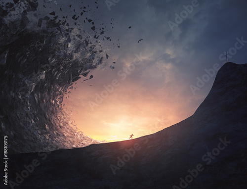 Photo  Man runs from large tsunami