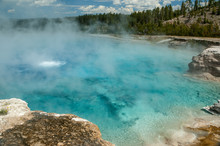 Clear, Steaming Aquamarine Water In Yellowstone Hot Spring, Wyoming
