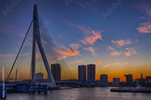 Aluminium Prints Rotterdam Travel Concepts, Ideas and Destinations.Picturesque View of Erasmus Bridge in Rotterdan Before the Sunset. City Scyline with Lights Off.