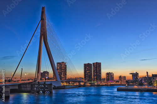Fotobehang Oceanië Travel Concepts, Ideas and Destinations. Amazing Cool View of Rotterdam Skyline with Erasmus Bridge on Foregorund During Blue Hour.