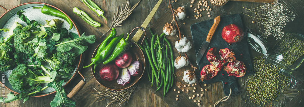 Fototapety, obrazy: Winter vegetarian, vegan food cooking ingredients. Flat-lay of seasonal vegetables, fruit, beans, cereals, kitchen utencils, dried flowers, olive oil over wooden background, top view, wide composition