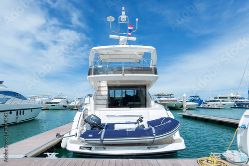 A luxury yacht docked in the parking of boats and yachts in Ocean Marina Thailand