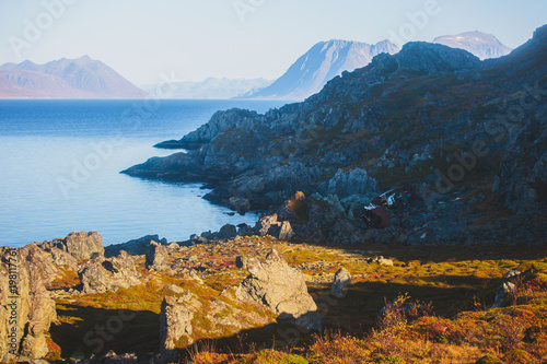 Shipwreck against the rocks along the norwegian fjord in Northern Norway