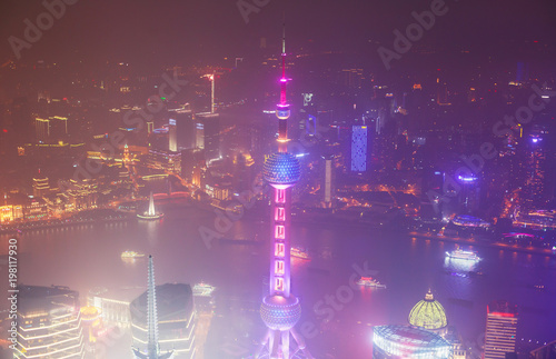 Poster Violet Beautiful super wide-angle night aerial view of Shanghai, China with Pudong district, TV tower, the Bund and scenery beyond the city, seen from the observation deck of Shanghai World Financial Center