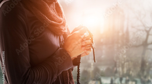 Canvas Print - Christian Religion and hope concept. Woman hands praying with rosary and wooden cross.