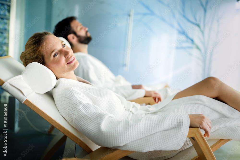 Fototapeta Handsome man and beautiful woman relaxing in spa