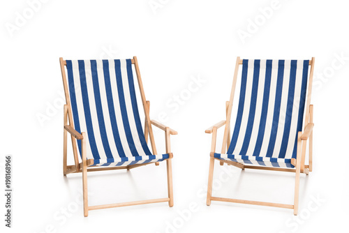 Photo two striped beach chairs, isolated on white