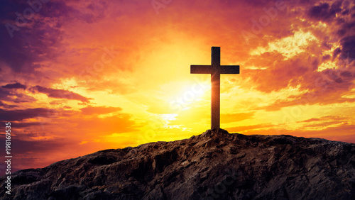 Silhouetted christian cross silhouette on the mountain at sunset Fotobehang