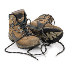 Used Hiking Boots Isolated On White Background
