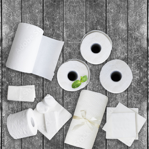 Fotomural  Paper tissue, white toilet  paper rolls, towels, napkins, cotton pads stacked on rustic wooden table