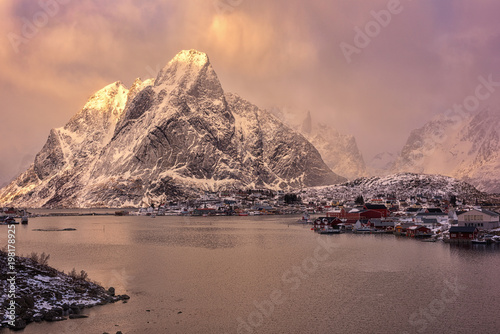 Foto op Aluminium Zalm Dramatic Norwegian winter landscape during storm at sunset, Reine - favorite tourist destination in the Lofoten Islands, Northern Norway
