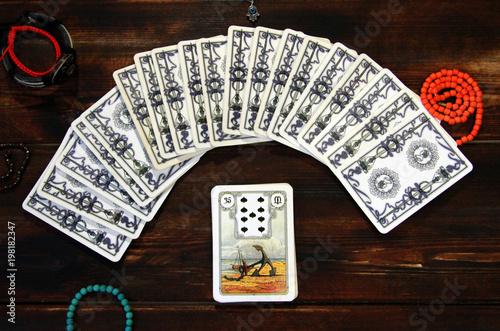 Tarot cards, magic, divination, prediction, wooden background © Olechka
