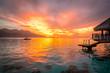 Romantic colorful sunset on a tropical island. Stunning view from overwater bungalow.