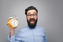 Scared Man With Alarm Clock