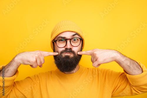Fotografía  Grimacing hipster making faces at camera