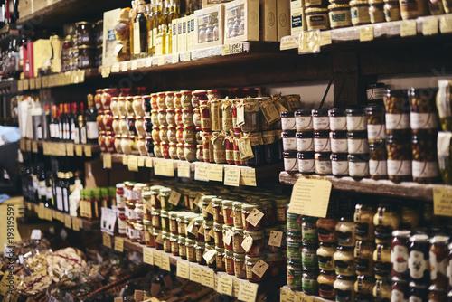 Fotografie, Obraz  Jars of food in a delicatessen in Italy